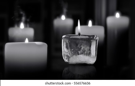 Glowing mourning candles.