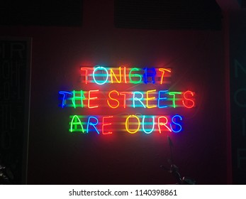 """Glowing neon city lights that read """"Tonight the streets are ours"""""""