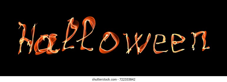 Glowing neon Halloween word over black background