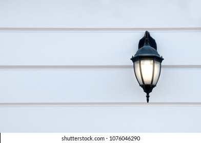glowing old street lamp on the wall