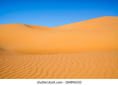 Glowing orange sand dunes in the desert of the United Arab Emirates near Liwa Oasis