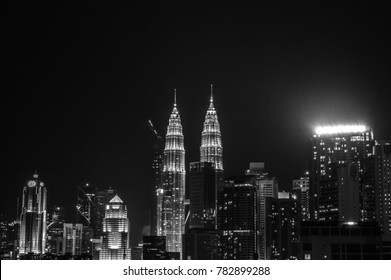 The glowing Petronas Twin Towers in the dark night sky of Kuala Lumpur city, Malaysia.