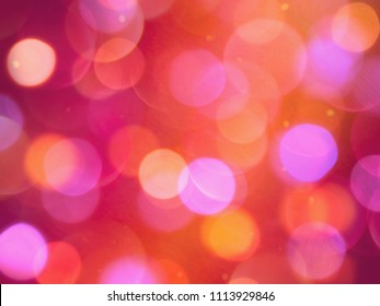 glowing pink blurred lights celebration abstract background with purple and orange colours