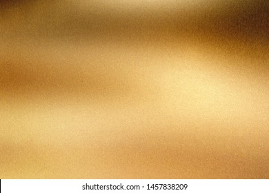 Glowing polished bronze wave steel plate, abstract texture background