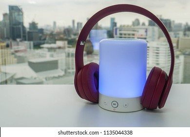 glowing portable Bluetooth speaker with wireless headphones for pairing to listen to music