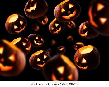 Glowing pumpkins levitate on a black background