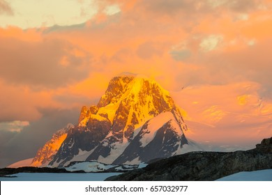 Glowing red mountains at sunset in Antarctica
