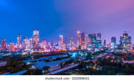 The glowing skyline of downtown Mumbai- Lower Parel and Worli at night, consisting of many residential and commercial skyscrapers and highrises.