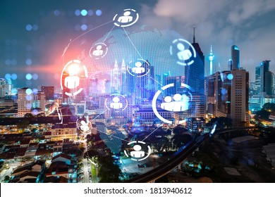 Glowing Social media icons on night panoramic city view of Kuala Lumpur, Malaysia, Asia. The concept of networking and connections between people and businesses in KL. Double exposure.