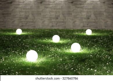 Glowing spheres in garden 3D rendering