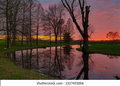 Glowing Sunset Over Water Mississippi Delta