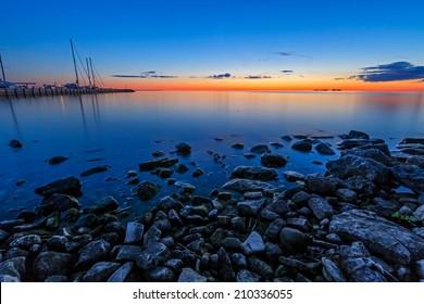 A glowing sunset sky illuminates the marina at Sister Bay in Door County, Wisconsin.