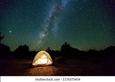 Glowing tent under the Milky Way, Arizona, USA.