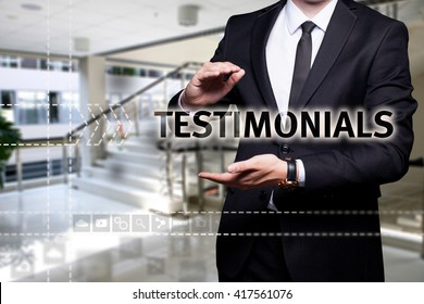 """Glowing text """"Testimonials"""" in the hands of a businessman. Business concept. Internet concept."""