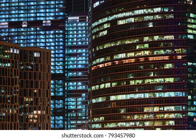 Glowing windows and facades of skyscrapers at night