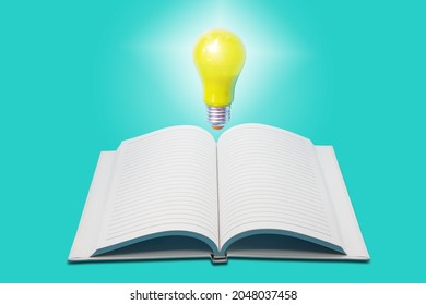 Glowing yellow light bulb with open white notebook on light green background , innovation and ideation concept