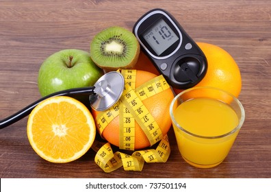 Glucometer for checking sugar level, medical stethoscope, fresh ripe fruits, glass of juice and tape measure, concept of diabetes and healthy lifestyles