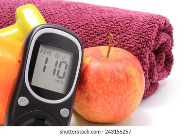 Glucometer, fresh fruits, dumbbells and purple towel for using in fitness, concept for diabetes lifestyle and healthy nutrition