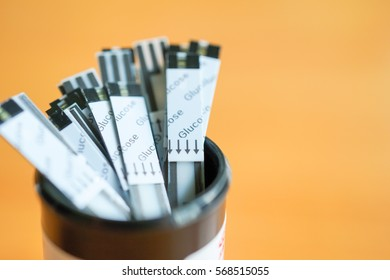 The glucometer, test strips, insulin against on wood table, Healthcare and medical technology background concept