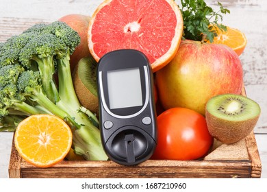Glucose meter for chcecking sugar level and natural healthy fruits with vegetables in wooden rustic box. Diabetes, diet and slimming concept
