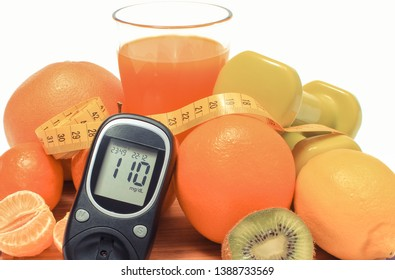 Glucose meter for checking sugar level and fresh ripe natural fruits with tape measure, concept of diabetes, slimming and healthy nutrition