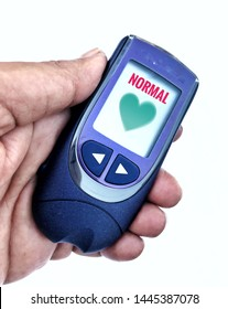 Glucose meter image, it's a glucose meter with normal and good sign of glucose levels is in the hand