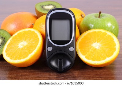 Glucose meter for measuring sugar level and fresh ripe fruits, concept of diabetes, healthy lifestyles nutrition and strengthening immunity
