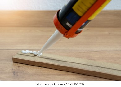 glue for fitting of skirting or washboard, laminate floor, renovation of the house