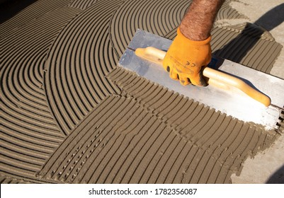 glue floors spread with notched trowel