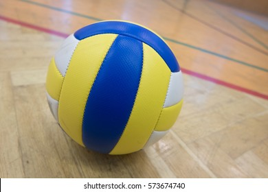 The glued yellow volleyball in the school gym