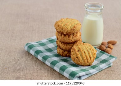 Gluten free almond coconut cookies with a bottle of milk
