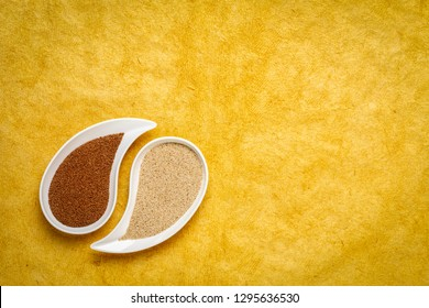 gluten free brown and ivory teff grain on teardrop shaped bowll against yellow textured paper - important food grain in Ethiopia and Eritrea