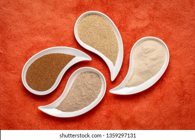 gluten free brown and ivory teff grain and flour on teardrop shaped bowls against red textured paper - important food grain in Ethiopia and Eritrea