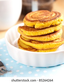 Gluten Free Coconut Flour Pancakes Served for Breakfast with Black Coffee and Maple Syrup