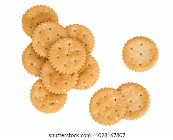 Gluten free crackers isolated on white. Small tasty biscuits with sesame seeds.