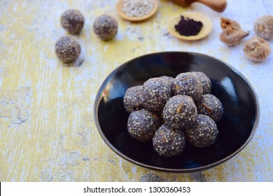 Gluten free energy balls with Maqui berry powder, acai powder, quinoa, fig, sunflower seed and coconut flakes