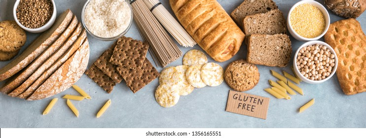 Gluten free food. Various gluten free pasta, bread, snacks and flour on light gray background, top view, banner.