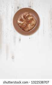 Gluten free homemade apple pie with almonds on white wooden background