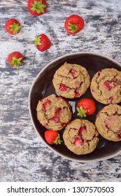 Gluten free muffins with fresh strawberries, flat lay