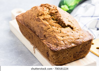 Gluten free zucchini  loaf cake on concrete background. Selective focus, space for text.