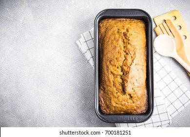 Gluten free zucchini loaf cake on concrete background. Top view,space for text.