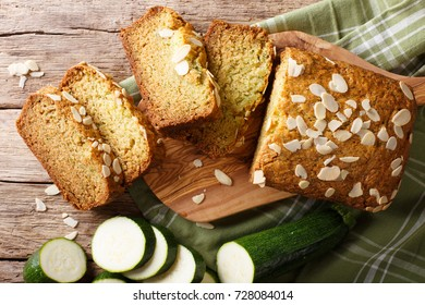 Gluten free zucchini loaf cake closeup on wooden background.horizontal top view from above