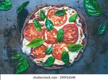 Gluten-free Caprese Pizza with Mozzarella.