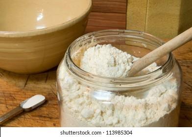 Gluten-free flour for baking, in an old jar with spoon: contains garbanzo bean, potato, tapioca, sorghum, and fava bean flours.  Also, 3/4 teaspoon xanthan gum - important for gluten-free baking.