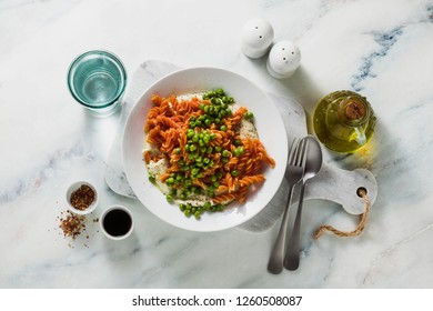 gluten-free healthy vegan red lentil pasta with green peas and cauliflower puree with garlic. tasty mac and cheese fusilli  for celiac disease