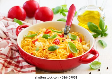 Gluten-free pasta with tomato sauce and cheese.