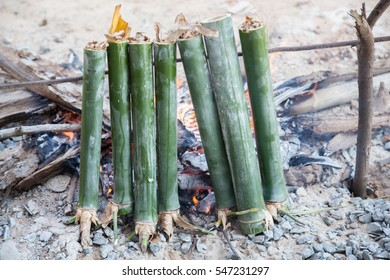 "glutinous rice baked in a bamboo cylinder. Thai food call ""khao lam"""