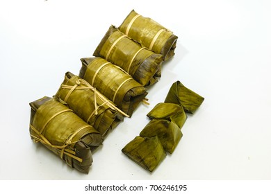 Glutinous rice steamed in banana leaf, concept isolated with white background,Thailand dessert.other name is Khao Tom Mat,countryside dessert.Bananas with Sticky Rice.
