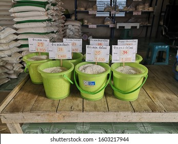 glutinous rice  or sticky rice uncooked in the green basket with cost at the rice mill Lampang, Thailand on 2 Jan, 2020