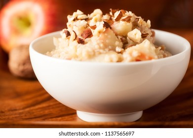 Glutten free porridge with millet, apple and chopped hazelnut